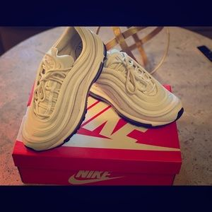 Icy white Nike 97's in a Woman's 9
